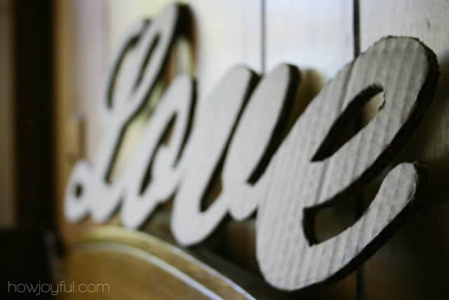 cutting the cardboard lettering