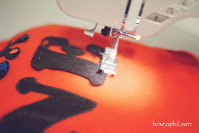 sewing the ticket pillow