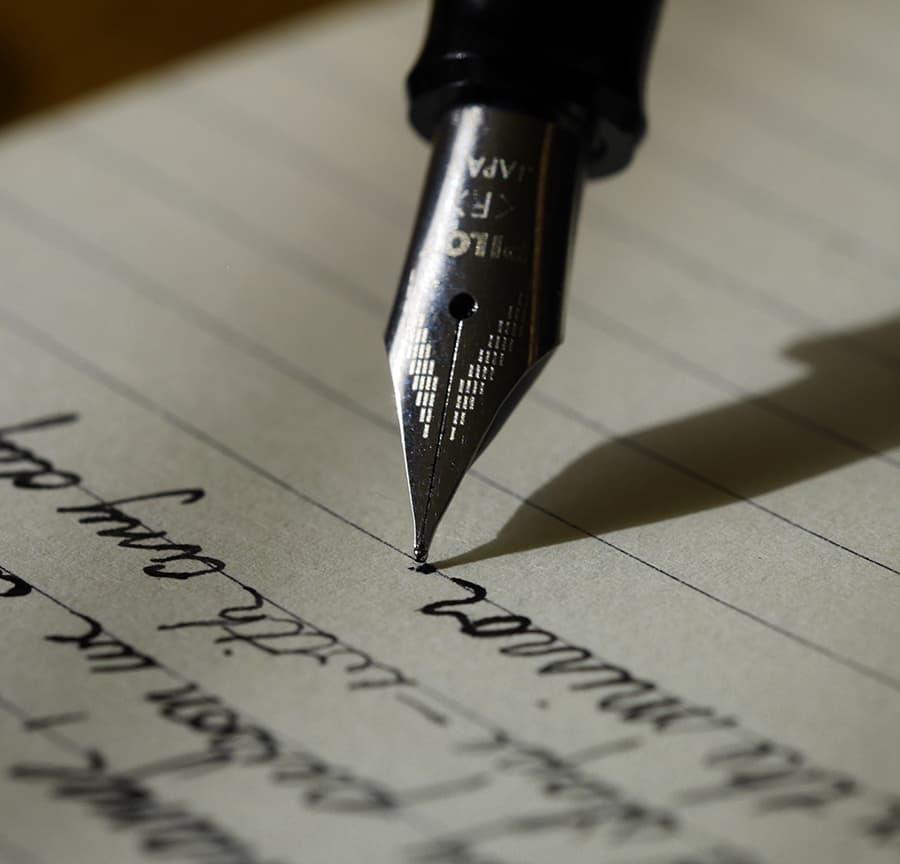 cursive pointed pen